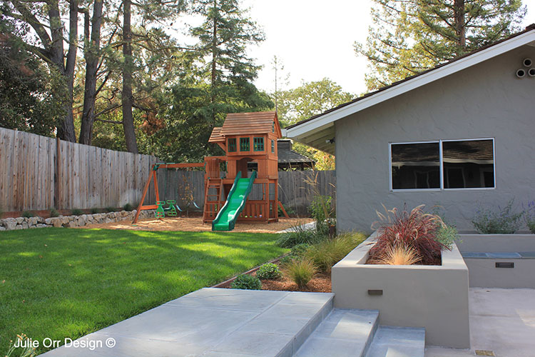 The kid's can enjoy their play space with a large lawn