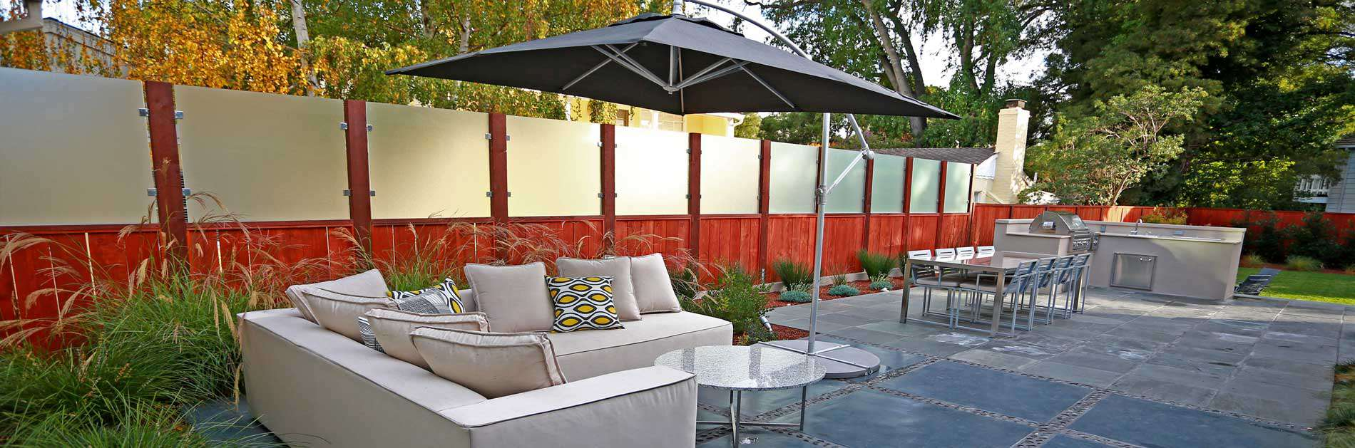 Backyard patio with seating and umbrella