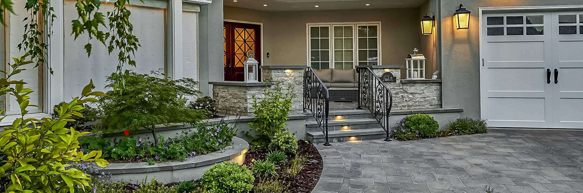 Front entryway with flagstone driveway and landscaped garden feature