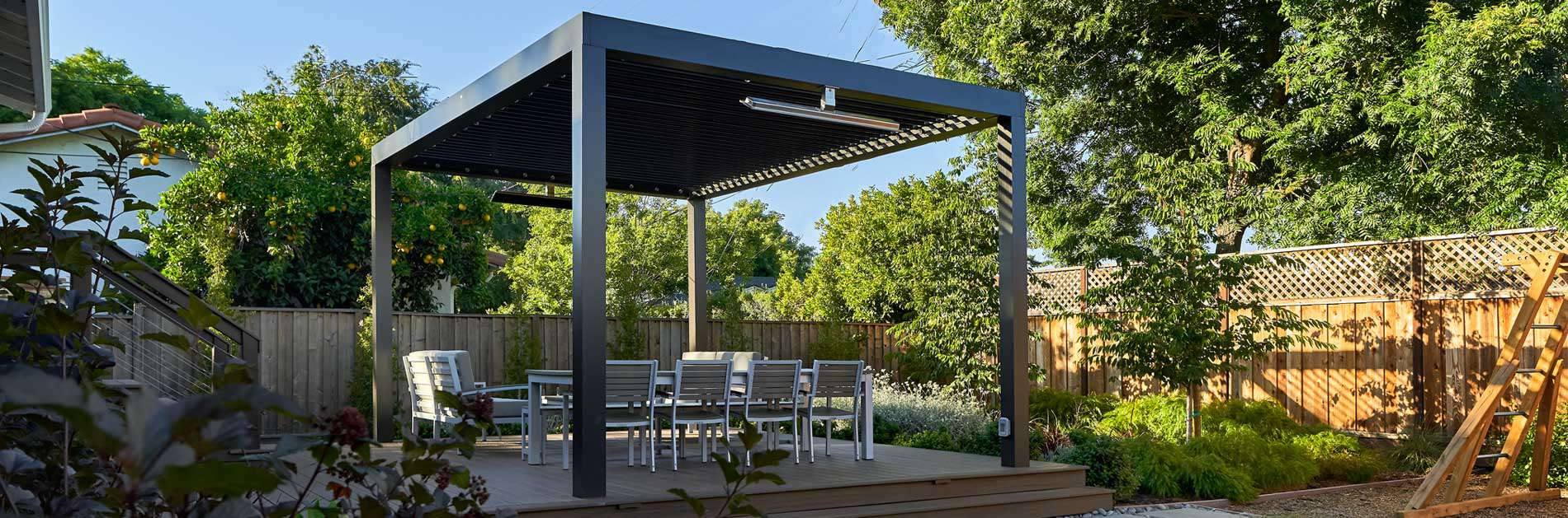Backyard pergola-covered patio with seating