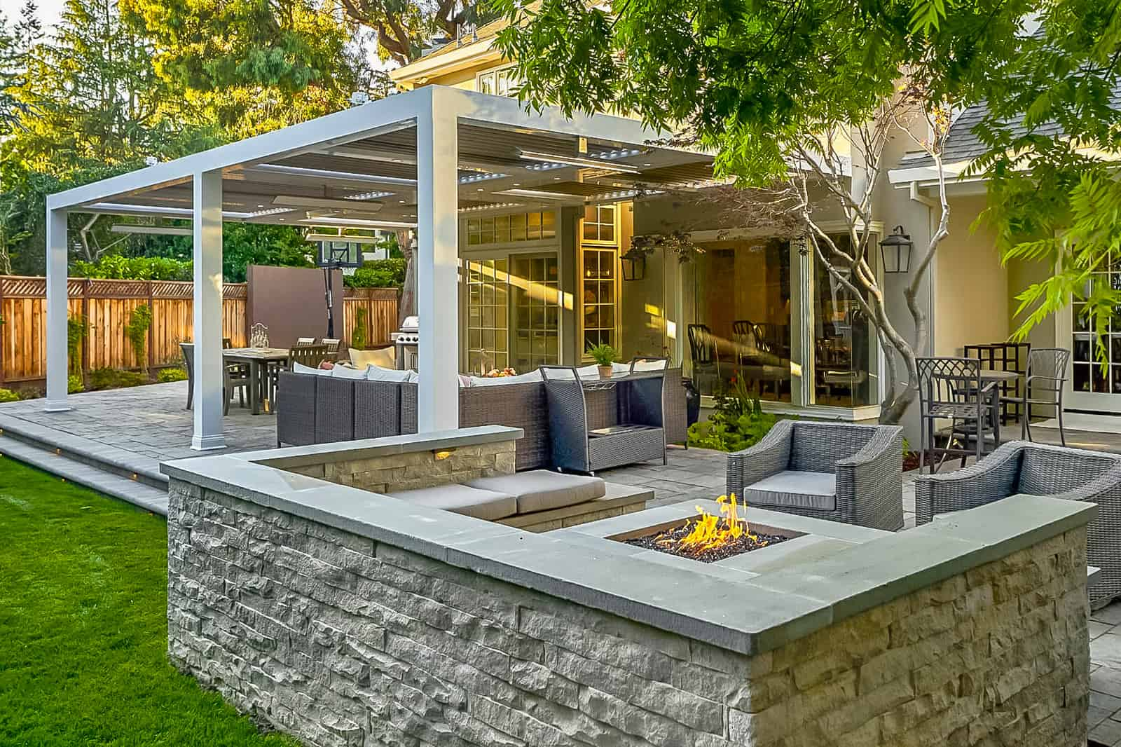 Outdoor living space with pergola and fire element
